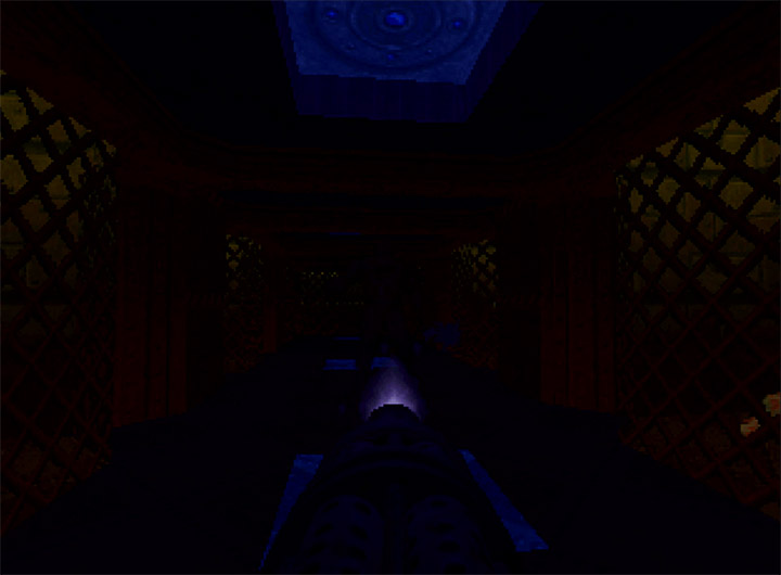 Shooting a nightmare imp in a darkened corridor in Doom 64 (N64)