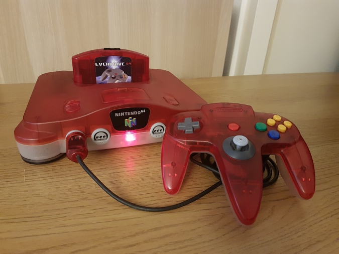 EverDrive 64 V3 in a red and white transparent N64 console
