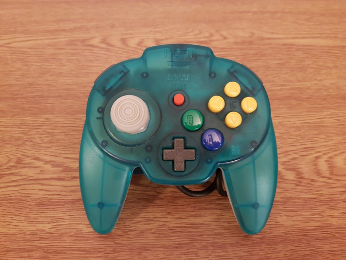 A transparent aqua and white N64 Hori Mini Pad