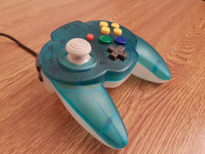 A close up of the N64 Hori Mini Pad's GameCube-style joystick