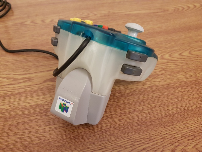 An N64 Hori Mini Pad with a Rumble Pak inserted into it
