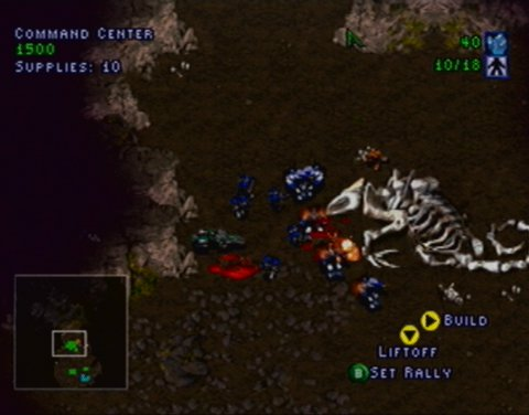 Terran units skirmishing with the Zerg in Starcraft 64