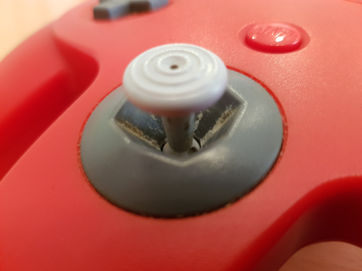 Abrasive dust that forms in an N64 controller joystick