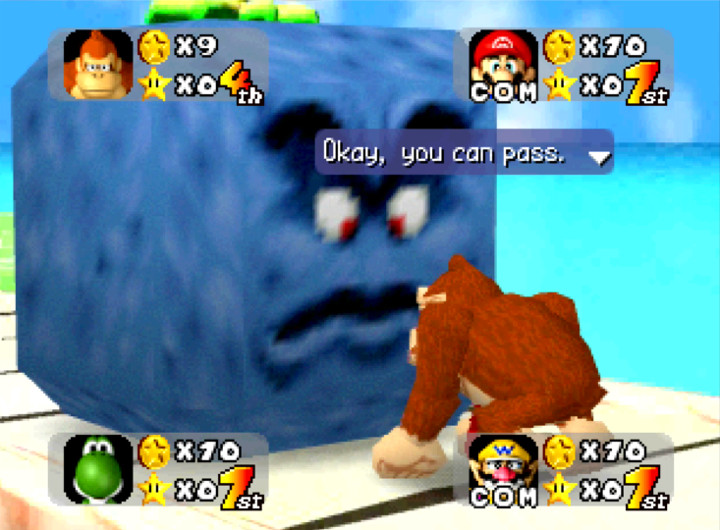 DK pays the Thwomp's toll to cross the bridge in Mario Party's Yoshi's Tropical Island board on Nintendo 64