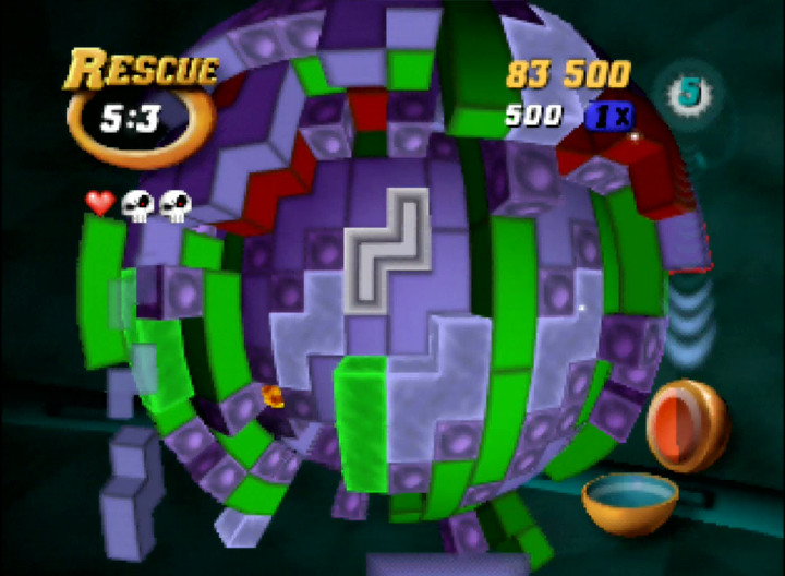 Removing layers of blocks in Tetrisphere for Nintendo 64.