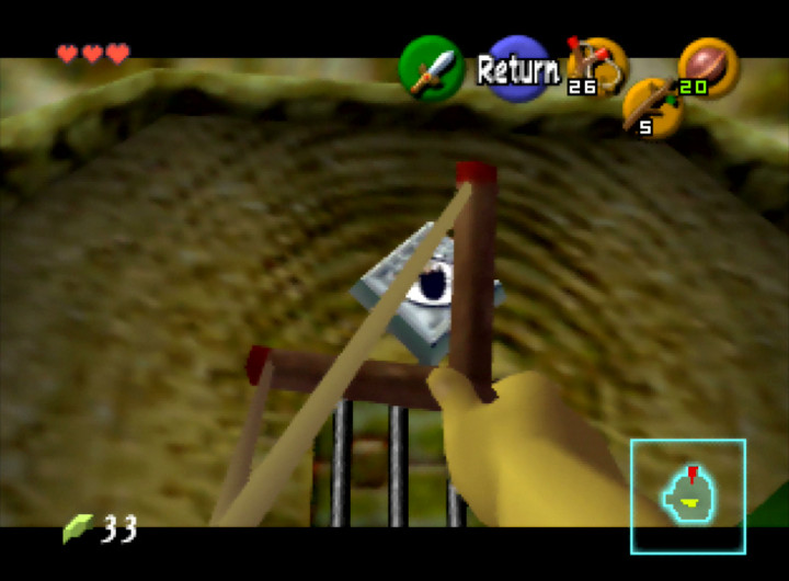 Aiming at an eye switch with the slingshot in The Legend of Zelda: Ocarina of Time for N64.