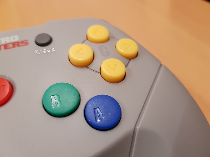 Photo highlighting the gap between the A/B and C buttons on the Brawler64 controller.