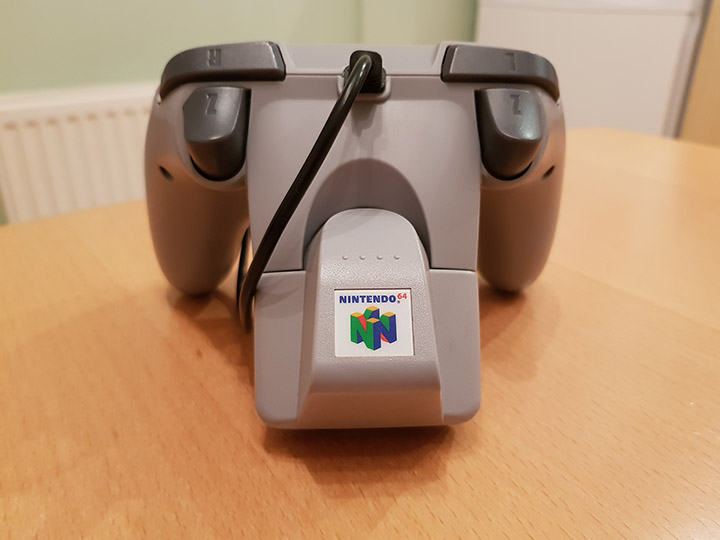 A Brawler 64 controller by Retro Fighters with a Rumble Pak inserted