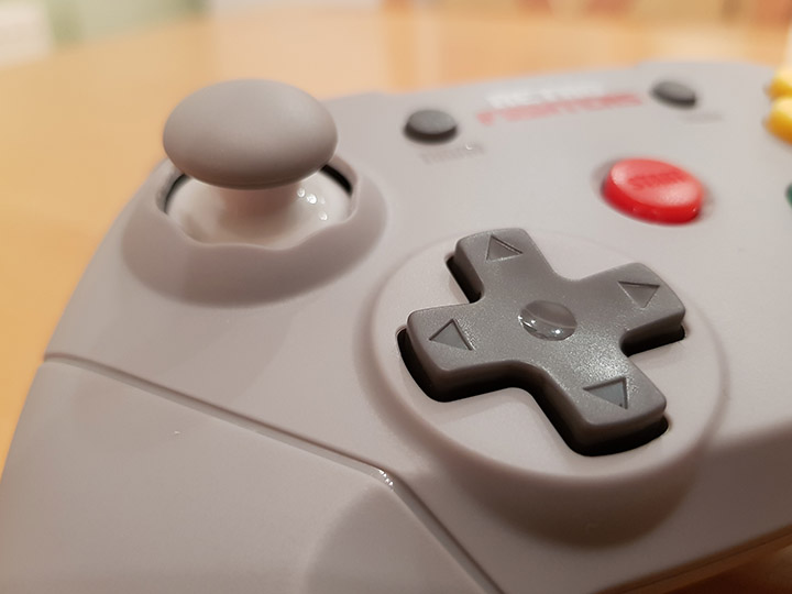 The Retro Fighters Brawler 64 controller's D-pad.