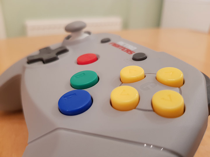 Close up shot of the face buttons of the Retro Fighters Brawler 64 controller