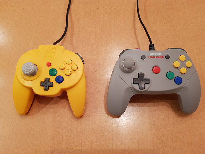 A comparison shot of the Hori N64 Mini Pad and the Retro Fighters Brawler 64 controller