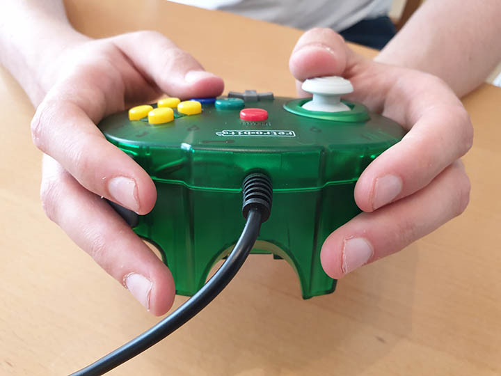 Holding down all four shoulder buttons on the Tribute 64 controller by Retro-bit
