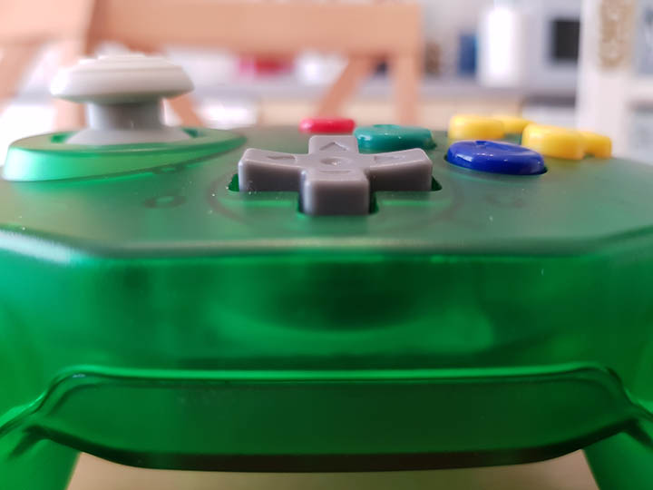 Base of the Close-up shot of the Retro-Bit Tribute 64 controller where the D-pad sits.