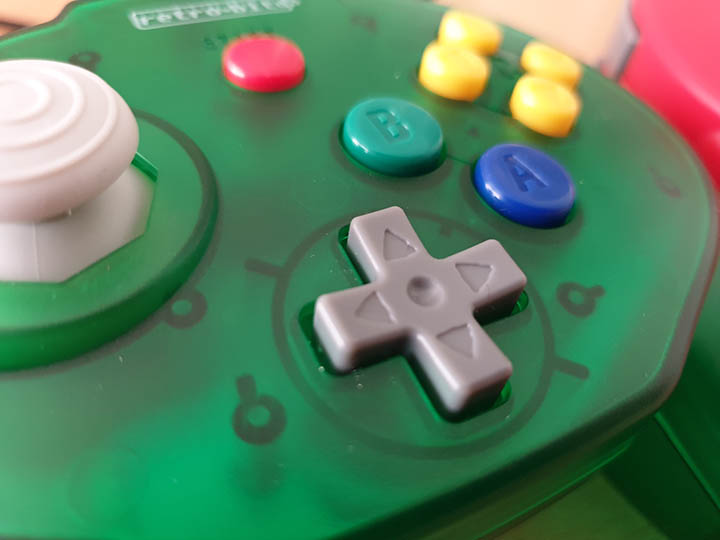 Close-up shot of the Retro-Bit Tribute 64 controller D-pad.