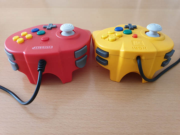 Comparison of Close-up shot of the Retro-Bit Tribute 64 controller and N64 Hori Mini Pad from the top of the controller.