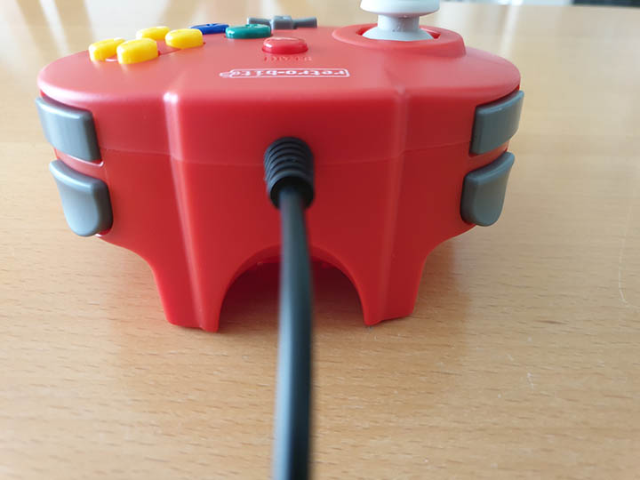 Shoulder buttons and cable of the Close-up shot of the Retro-Bit Tribute 64 controller.