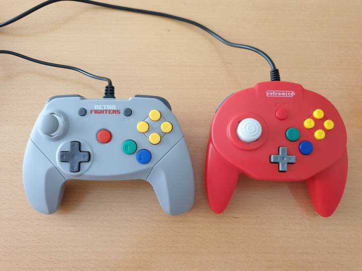 Comparison photo of the Retro Fighters' Brawler 64 controller (left) and the Retro-Bit Tribute 64 controller (right).
