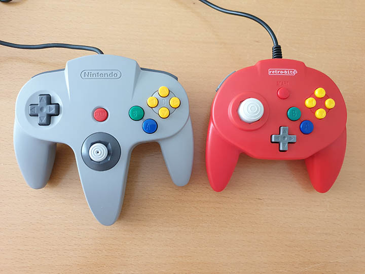 Comparison photo of the official N64 controller (left) and the Retro-Bit Tribute 64 controller.