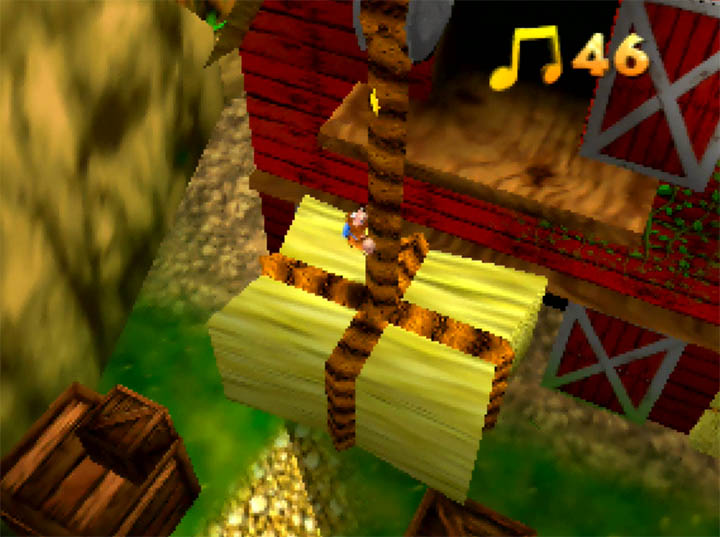 Banjo climbs up a crane holding a haystack in Banjo-Kazooie: The Hidden Lair for N64.
