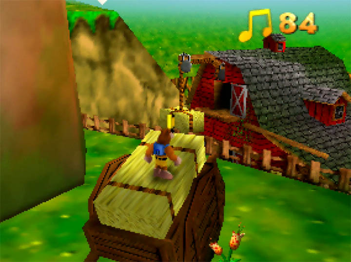 Standing atop a wagon of hay in Banjo-Kazooie: The Hidden Lair for Nintendo 64