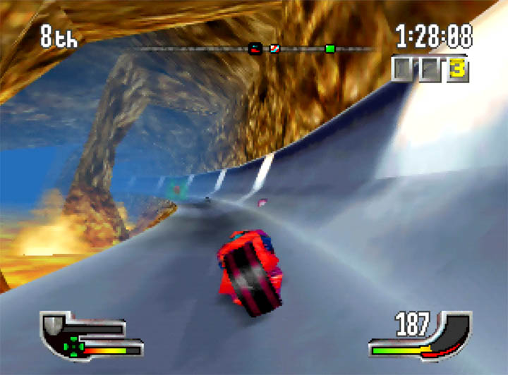 Driving round a track set inside a lava-filled volcano in Extreme-G on N64.