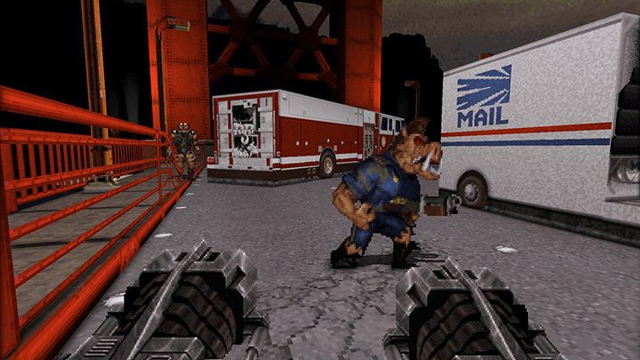 Duke Nukem gets ready to unload a ton of bullets into a pig cop enemy