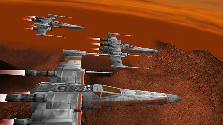 X-wings fly in formation over the planet of Kessel in Star Wars: Rogue Squadron 3D for PC.