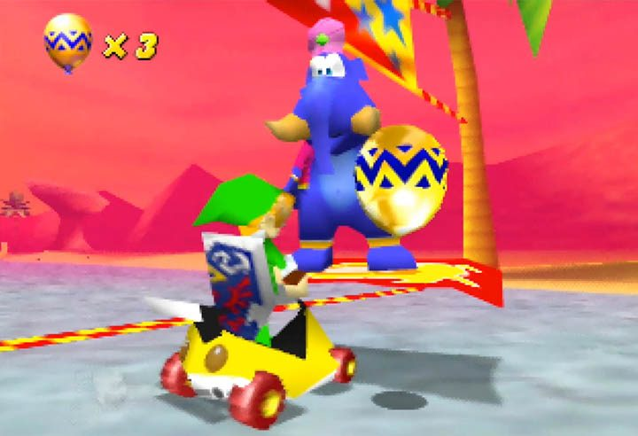 Link wins a golden balloon in Diddy Kong Racing's Adventure mode.
