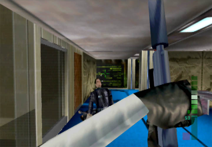 Joanna Dark takes out a Datadyne guard with a Falcon 2 Silencer in Perfect Dark.