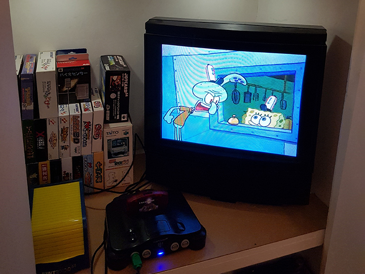 Watching Spongebob Squarepants on an N64 connected to a CRT TV.