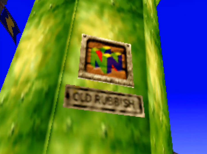 """A sign on the side of a Super Mario pipe saying """"Old Rubbish"""" below an N64 logo."""