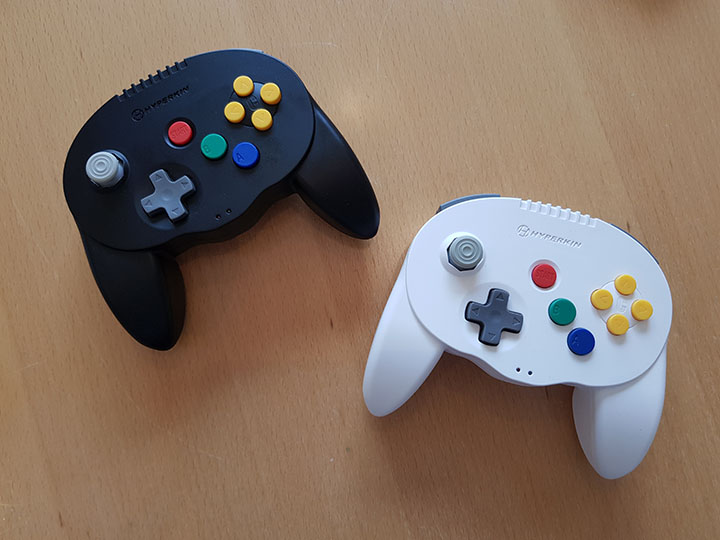 Hyperkin Admiral wireless N64 controller in black and white