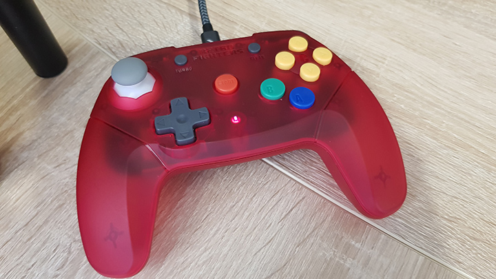 The LED indicator showing the controller is charging.