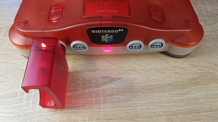 Dongle light on, confirming that the controller is connected to the N64 console.
