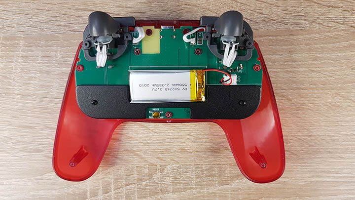 The battery is replaceable, but you need to remove the back of the controller to do this.