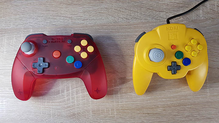 Hori N64 Mini Pad sat next to the slightly larger Retro Fighters Brawler 64 wireless controller